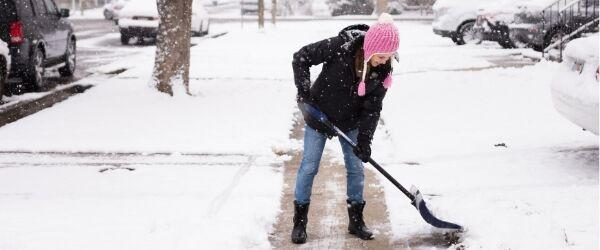 Lady shoveling snow