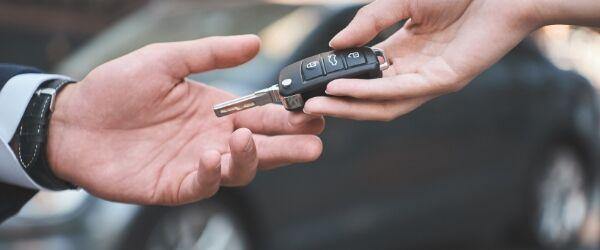 Passing car key to renter.