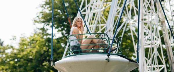 Girl on a ride - It is important to set aside money for the fun things in life.