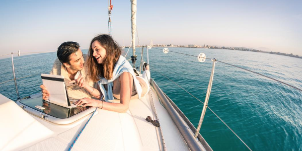 Couple on a sailboat - rich people often live beyond their means and aren't independently wealthy.