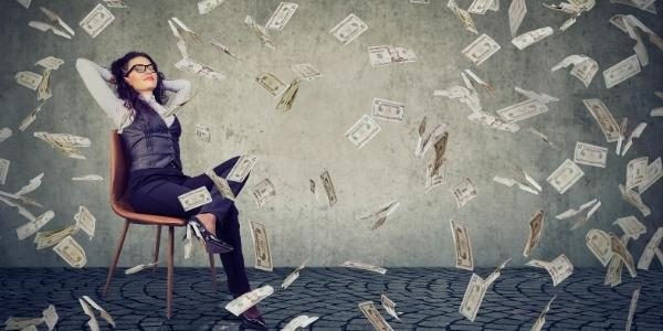 Lady in chair with money raining down