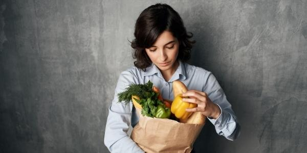 Woman checking her grocery delivery